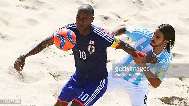Ozu Moreira of Japan is challenged by Federico Costas of Argentina during the FIFA Beach Soccer World Cup Portugal 2015 Group A match between Japan...