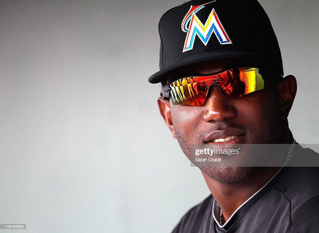 Ozunda #34 of the Miami Marlins looks on from the dugout before a game against the Detroit Tigers at Roger Dean Stadium on March 6, 2012 in Jupiter, Florida.