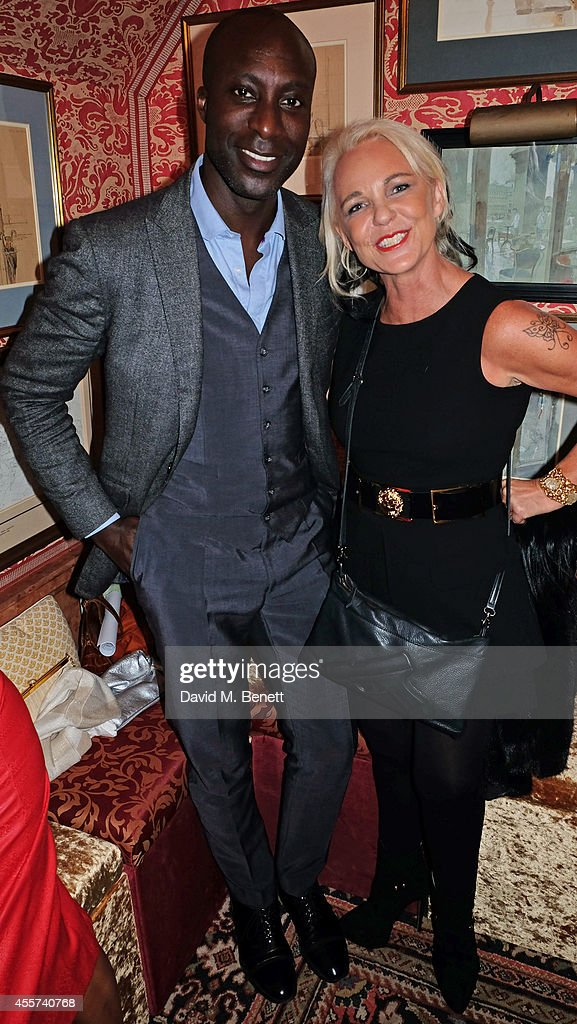 Ozwald Boateng and Amanda Eliasch attend the 35th Birthday of Harry's Bar on September 19 2014 in London England