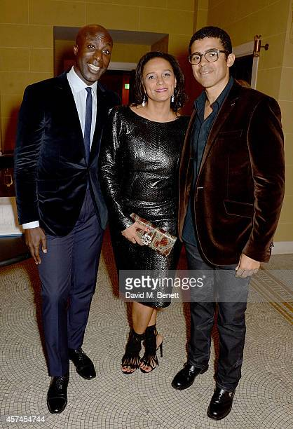 Ozwald Boateng Isabel dos Santos and Sindika Dokolo attend the Sindika Dokolo Art Foundation dinner at Cafe Royal on October 18 2014 in London England