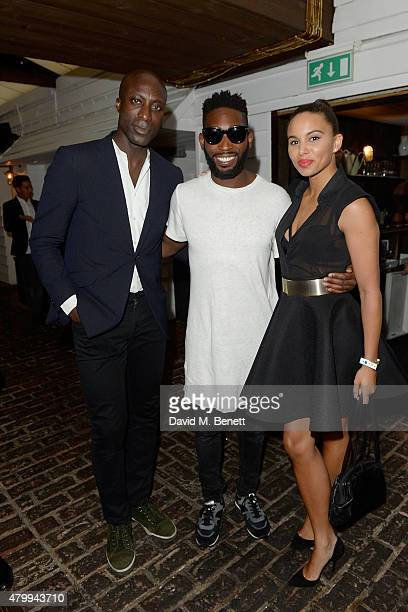 Ozwald Boateng Tinie Tempah and Louise Hazel attend the Warner Summer Party in association with British GQ at Shoreditch House on July 8 2015 in...