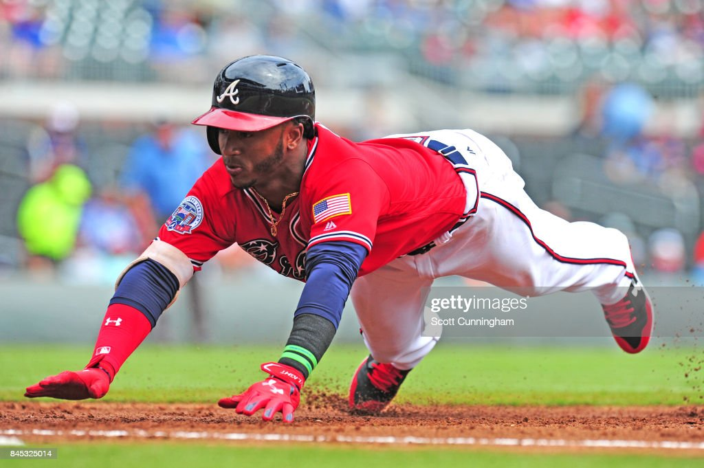 Ozzie Albies #1 of the Atlanta Braves dives back to first base during the first inning against the Miami Marlins at SunTrust Park on September 10, 2017 in Atlanta, Georgia.