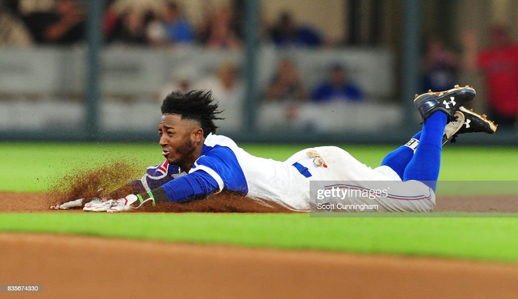 Ozzie Albies #1 of the Atlanta Braves dives in to second base for a seventh inning double against the Cincinnati Reds at SunTrust Park on August 19, 2017 in Atlanta, Georgia.