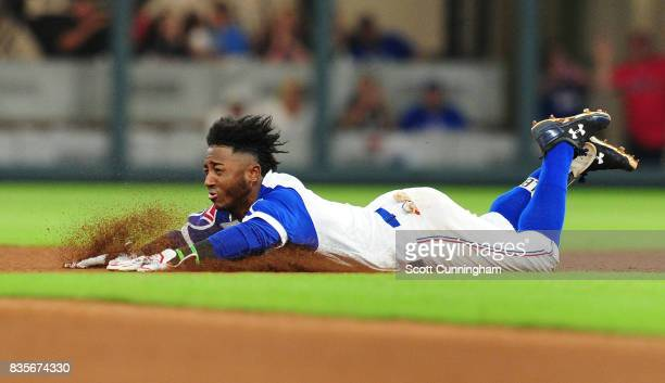 Ozzie Albies of the Atlanta Braves dives in to second base for a seventh inning double against the Cincinnati Reds at SunTrust Park on August 19 2017...