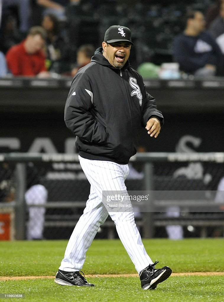 Ozzie Guillen # 13 manager of the Chicago White Sox goes out to talk to his pitcher in the ninth inning against the Oakland Athletics on June 11, 2011 at U.S. Cellular Field in Chicago, Illinois. The Sox defeated the Athletics 3-2.