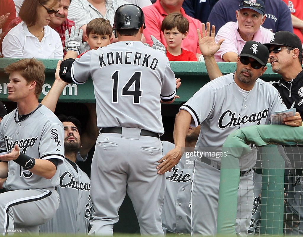 <a gi-track='captionPersonalityLinkClicked' href=/galleries/search?phrase=Ozzie+Guillen&family=editorial&specificpeople=210514 ng-click='$event.stopPropagation()'>Ozzie Guillen</a> #13 of the Chicago White Sox congratulates <a gi-track='captionPersonalityLinkClicked' href=/galleries/search?phrase=Paul+Konerko&family=editorial&specificpeople=203327 ng-click='$event.stopPropagation()'>Paul Konerko</a> #14 after he hit a two run homer in the ninth inning against the Boston Red Sox on June 1, 2011 at Fenway Park in Boston, Massachusetts. The Chicago White Sox defeated the Boston Red Sox 7-4.
