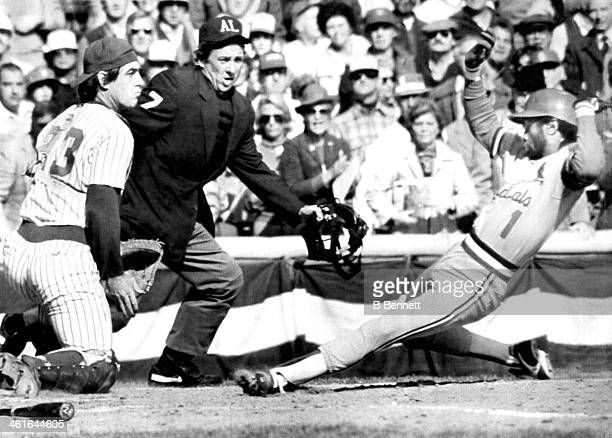 Ozzie Smith of the St Louis Cardinals scores from second as catcher Ted Simmons of the Milwaukee Brewers can't make the tag during Game 4 of the 1982...
