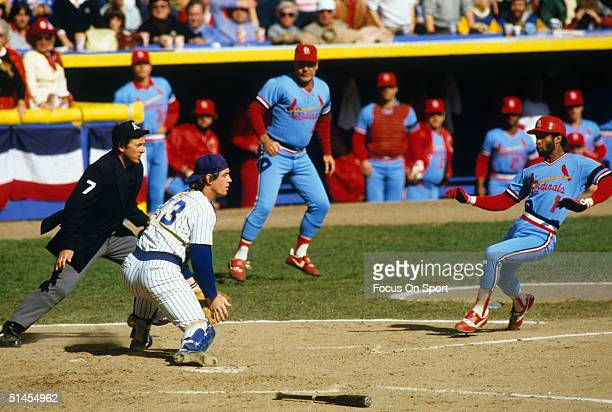 Ozzie Smith of the St Louis Cardinals slides home as catcher Ted Simmons of the Milwaukee Brewers waits for the throw during the World Series at...