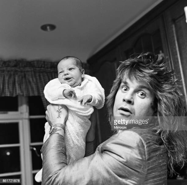 Ozzy Osbourne former lead singer of Black Sabbath pictured at home two weeks after the birth of his baby boy Jack 25th November 1985