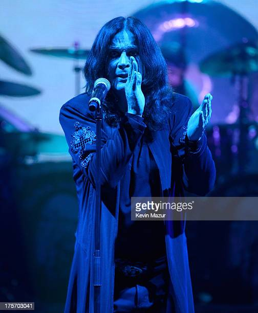 Ozzy Osbourne of Black Sabbath performs during their '13' Tour at PNC Bank Arts Center on August 4 2013 in Holmdel New Jersey