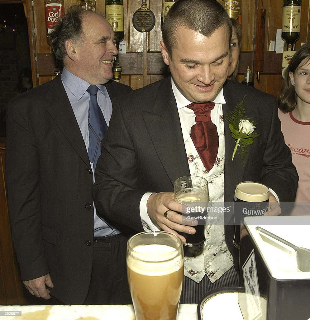 Ozzy Osbourne's son <a gi-track='captionPersonalityLinkClicked' href=/galleries/search?phrase=Louis+Osbourne&family=editorial&specificpeople=2522530 ng-click='$event.stopPropagation()'>Louis Osbourne</a> holds pints at his reception following his wedding to Louise Lennon in Saint Flannan's church December 31, 2003 in Co. Offaly, Ireland. Their reception was held at the gothic Kinnitty Castle, with 160 guests in attendance, but one notable absentee was Louis's famous father, who was unable to attend on account of a near-fatal quad-biking accident a few weeks earlier.