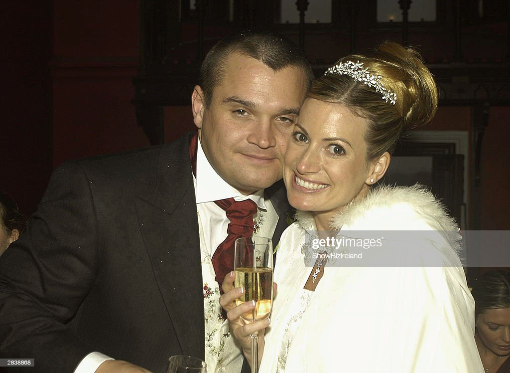 Ozzy Osbourne's son <a gi-track='captionPersonalityLinkClicked' href=/galleries/search?phrase=Louis+Osbourne&family=editorial&specificpeople=2522530 ng-click='$event.stopPropagation()'>Louis Osbourne</a> poses with his bride Louise Lennon in Saint Flannan's church December 31, 2003 in Co. Offaly, Ireland. Their reception was held at the gothic Kinnitty Castle, with 160 guests in attendance, but one notable absentee was Louis's famous father, who was unable to attend on account of a near-fatal quad-biking accident a few weeks earlier.
