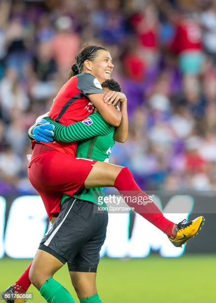 p12 and Portland Thorns FC goalkeeper Adrianna Franch celebrate winning the NWSL Championship during the NWSL soccer Championship match between the...