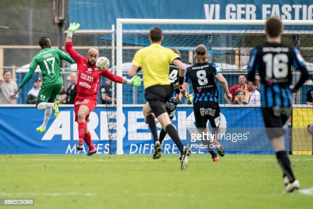 Pa Amat Dibba of Hammarby IF shoots and Joschua Wicks goalkeeper of IK Sirius FK saves during the Allsvenskan match between IK Sirius FK and Hammarby...
