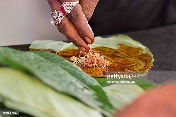 Paan is being prepared
