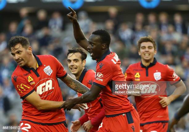 Paba Babacar Diawara of Adelaide United celebrates after scoring a goal during the round 10 ALeague match between the Melbourne Victory and Adelaide...