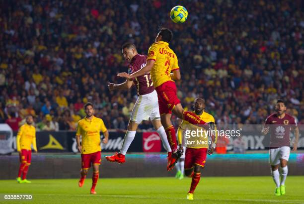 Pablo Aguilar of America and Enrique Perez of Morelia go for a header during the 5th round match between Morelia and America as part of the Torneo...