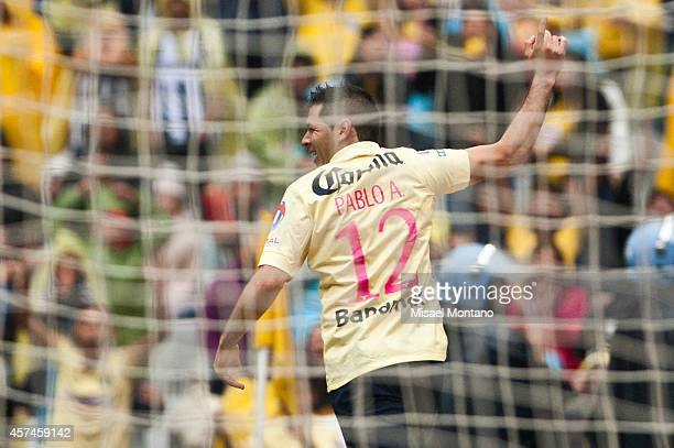 Pablo Aguilar of America celebrates after scoring the first goal of his team during a match between America and Monterrey as part of 13th round...