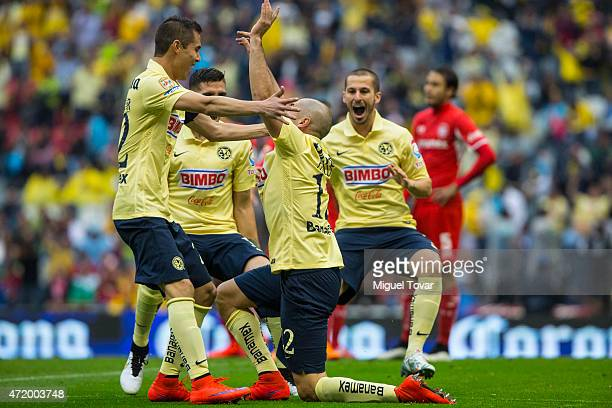 Pablo Aguilar of America celebrates after scoring the first goal of his team during a match between America and Toluca as part of 16th round of...