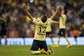 Pablo Aguilar of America celebrates after winning a match during a quarterfinal second leg match between America and Pumas UNAM as part of the...