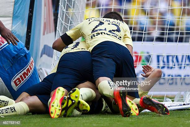 Pablo Aguilar of America celebrates with Paolo Goltz after scoring the winning goal during a match between America and Tijuana as part of 2nd round...