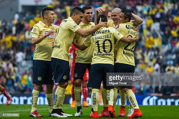 Pablo Aguilar of America celebrates with teammates after scoring the first goal of his team during a match between America and Toluca as part of 16th...