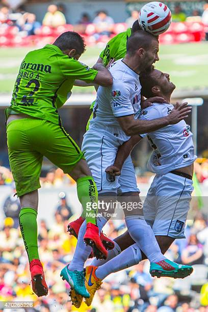 Pablo Aguilar of America fights for the ball with Emanuel Villa of Queretaro during a match between America and Queretaro as part of 14th round of...