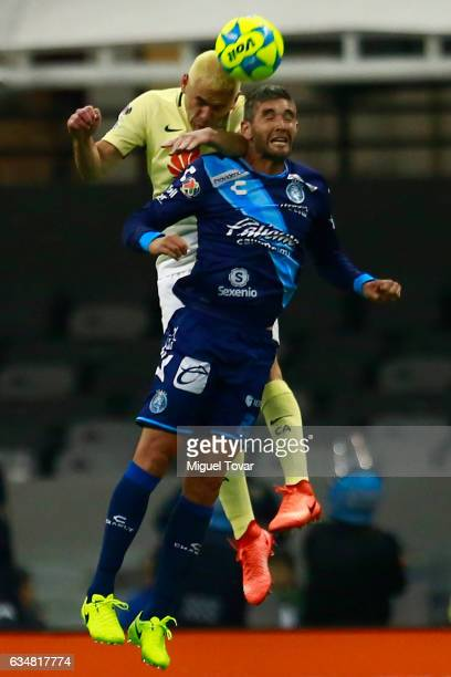 Pablo Aguilar of America heads the ball over Alvaro Navarro of Puebla during the 6th round match between America and Puebla as part of the Torneo...