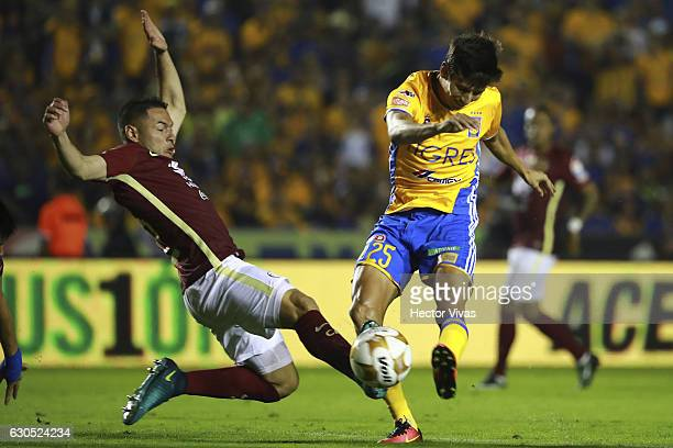 Pablo Aguilar of America slides as Jurgen Damm of Tigres drives the ball during the Final second leg match between Tigres UANL and America as part of...