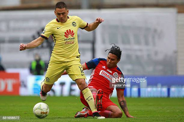 Pablo Aguilar of America struggles for the ball with Carlos Pe��–a of Chivas during the quarter finals second leg match between America and Chivas as...