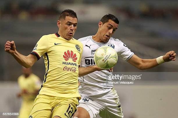 Pablo Aguilar of America struggles for the ball with Rogelio Funes Mori of Monterrey during the semi finals first leg match between America and...