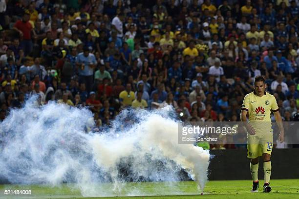 Pablo Aguilar of America walks away from a smoke bomb during the 14th round match between Queretaro and America as part of the Clausura 2016 Liga MX...