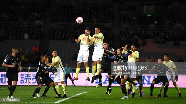 Pablo Aguilar of Club America and Oribe Peralta of Club America jump to win a header during the FIFA Club World Cup Semi Final match between Club...