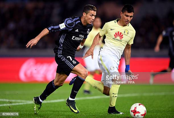 Pablo Aguilar of Club America chases down Cristiano Ronaldo of Real Madrid during the FIFA Club World Cup Semi Final match between Club America and...