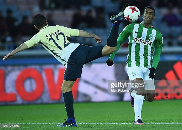 Pablo Aguilar of Club America competes for the ball against Orlando Berrio of Atletico Nacional during the FIFA Club World Cup 3rd place match...