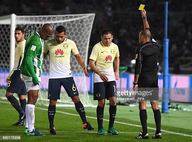 Pablo Aguilar of Club America is shown a yellow card during the FIFA Club World Cup 3rd Place match between Club America and Atletico Nacional at...