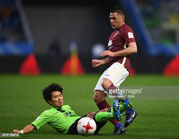 Pablo Aguilar of Club America is tackled by Jung Hyuk of Jeonbuk Hyundai during the FIFA Club World Cup second round match between Jeonbuk Hyundai...
