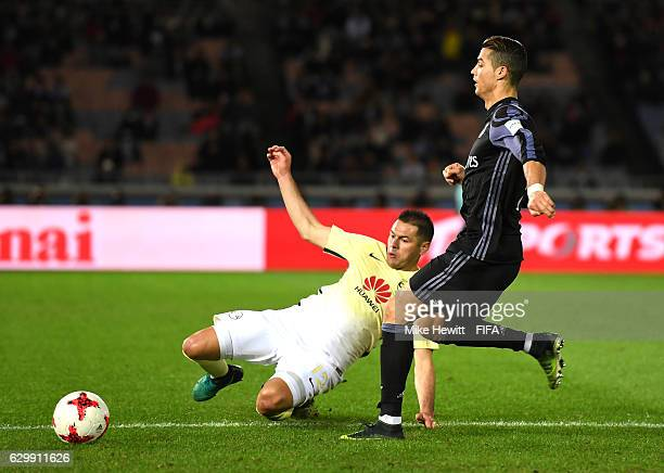 Pablo Aguilar of Club America tackles Cristiano Ronaldo of Real Madrid during the FIFA Club World Cup Semi Final match between Club America and Real...