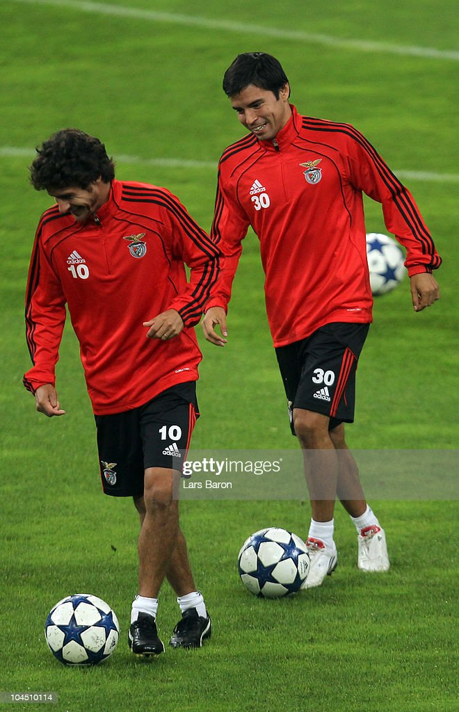 <a gi-track='captionPersonalityLinkClicked' href=/galleries/search?phrase=Pablo+Aimar&family=editorial&specificpeople=216627 ng-click='$event.stopPropagation()'>Pablo Aimar</a> and <a gi-track='captionPersonalityLinkClicked' href=/galleries/search?phrase=Javier+Saviola&family=editorial&specificpeople=207198 ng-click='$event.stopPropagation()'>Javier Saviola</a> smile during a SL Benfica training session ahead of the UEFA Champions League match against FC Schalke 04 at Veltins Arena on September 28, 2010 in Gelsenkirchen, Germany.