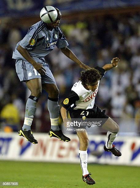 Pablo Aimar of Valencia clashes with Abdoulaye Meite of Marseille during the UEFA Cup Final match between Valencia and Olympique de Marseille at the...