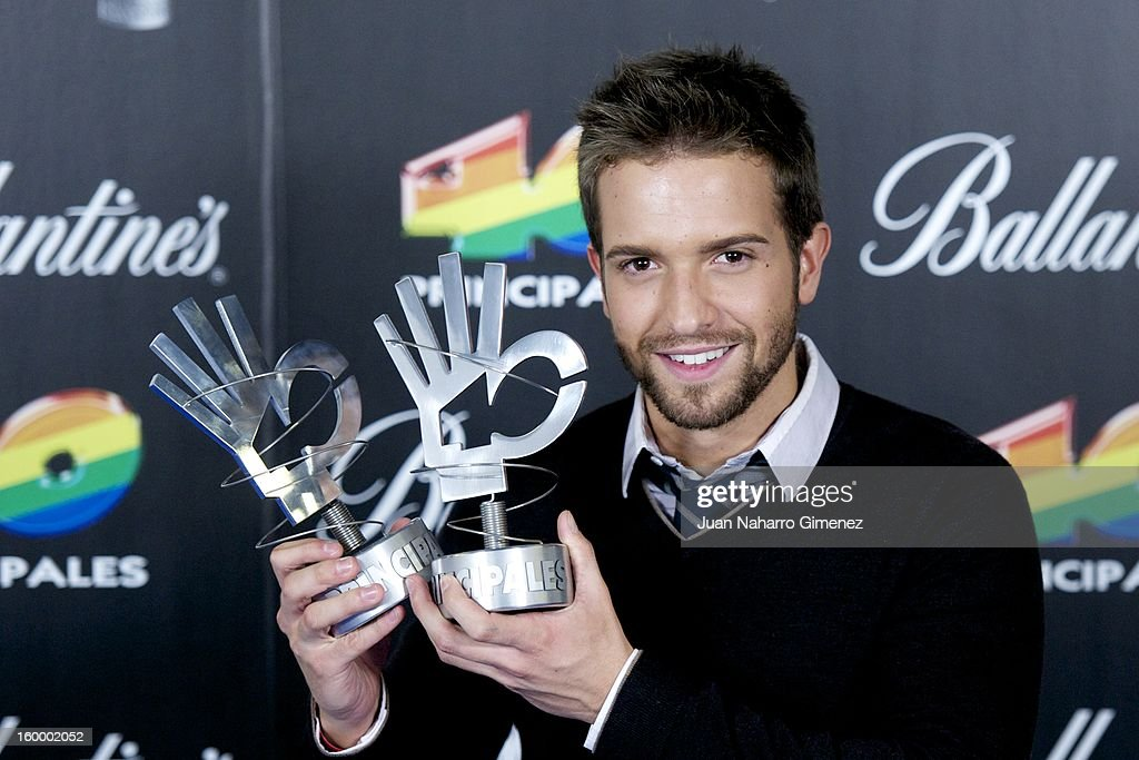 <a gi-track='captionPersonalityLinkClicked' href=/galleries/search?phrase=Pablo+Alboran&family=editorial&specificpeople=7512466 ng-click='$event.stopPropagation()'>Pablo Alboran</a> poses in the press room during 40 Principales Awards 2012 at the Palacio de Deportes on January 24, 2013 in Madrid, Spain.