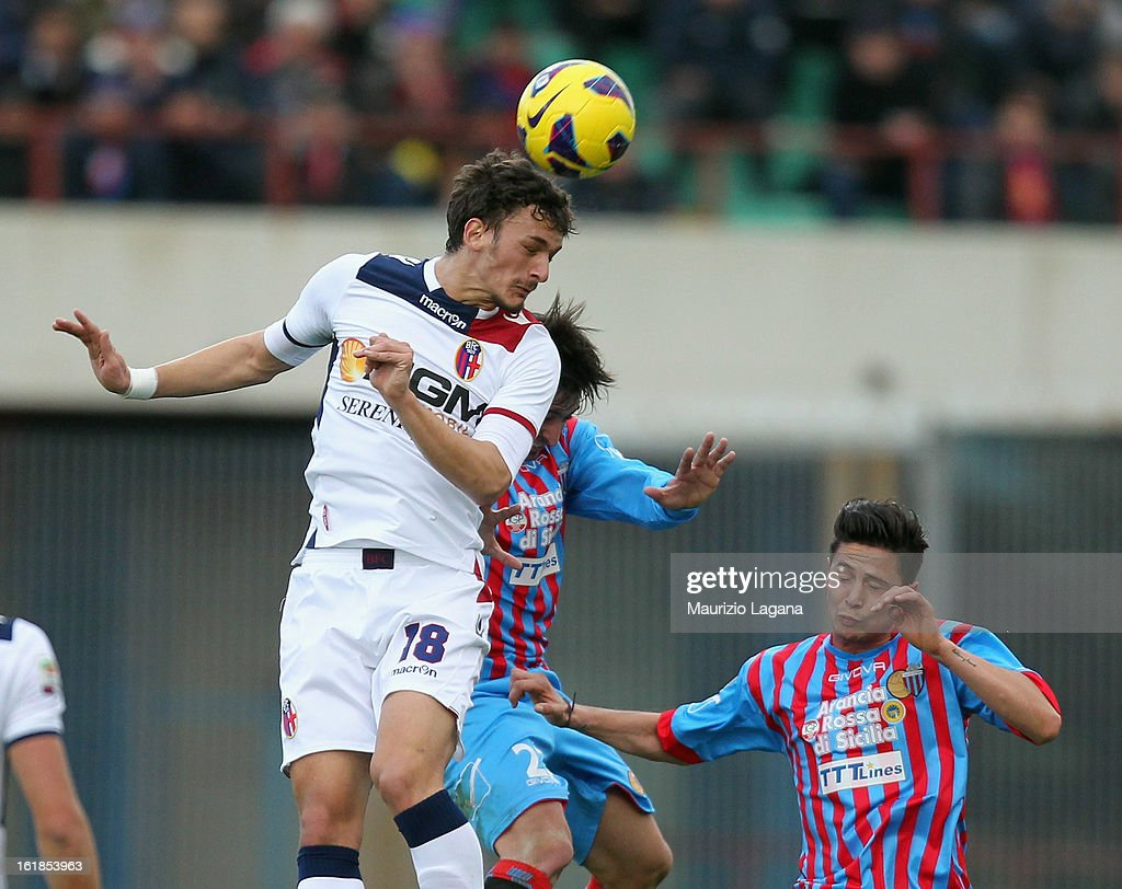 Pablo Alvarez (C) and Marco Biagianti of Catania competes for the ball in air with Manolo Gabbiadini of Bologna during the Serie A match between Calcio Catania and Bologna FC at Stadio Angelo Massimino on February 17, 2013 in Catania, Italy.