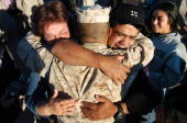 Pablo and Jana rodriguez hug their son Steven during a homecoming for Marines from the 2nd Battalion 4th Regiment September 24 2004 at Camp Pendleton...