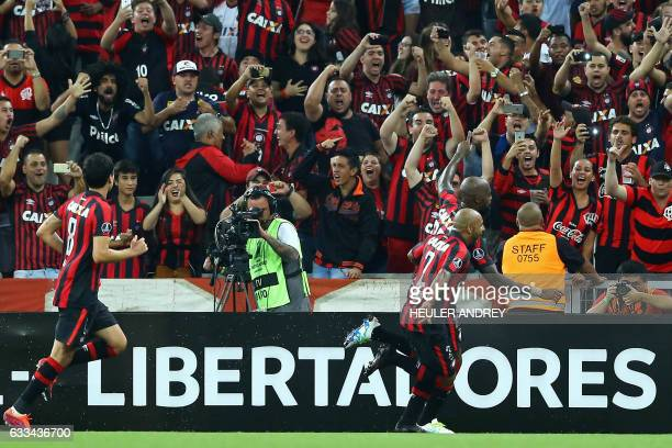 Pablo and Jonathan of Atletico Paranaense celebrate a goal scored during a match between Atletico Paranaense and Millonarios as part of the Copa...