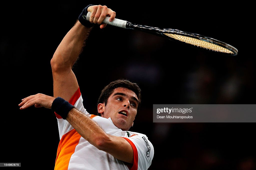 <a gi-track='captionPersonalityLinkClicked' href=/galleries/search?phrase=Pablo+Andujar&family=editorial&specificpeople=4424721 ng-click='$event.stopPropagation()'>Pablo Andujar</a> of Spain in action against Benoit Paire of France during day 1 of the BNP Paribas Masters at Palais Omnisports de Bercy on October 29, 2012 in Paris, France.