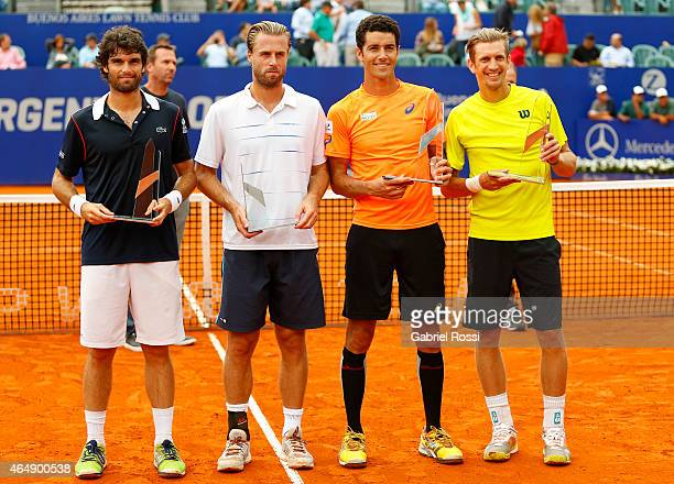 Pablo Andujar of Spain Oliver Marach of Austria and Andre Sa of Brazil and Jarko Nieminen of Finland pose with the trophy after finish the doubles...