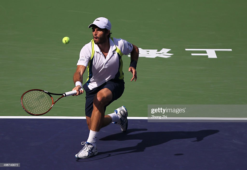 Pablo Andujar of Spain returns a shot during his match against John Isner of USA during the day 2 of the Shanghai Rolex Masters at the Qi Zhong Tennis Center on October 6, 2014 in Shanghai, China.
