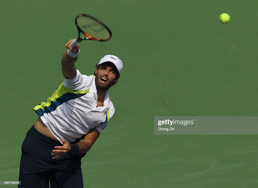 Pablo Andujar of Spain serves during his match against John Isner of USA during the day 2 of the Shanghai Rolex Masters at the Qi Zhong Tennis Center on October 6, 2014 in Shanghai, China.