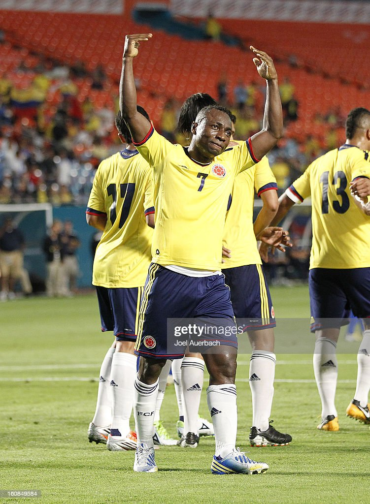 Pablo Armero #7 celebrates the goal by Abel Aguilar #8 (not pictured) of Colombia with fans during second half action against Guatemala on February 6, 2013 at SunLife Stadium Stadium in Miami Gardens, Florida. Colombia defeated Guatemala 4-1.