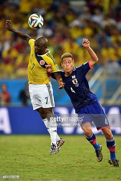 Pablo Armero of Colombia and Keisuke Honda of Japan compete for the ball during the 2014 FIFA World Cup Brazil Group C match between Japan and...